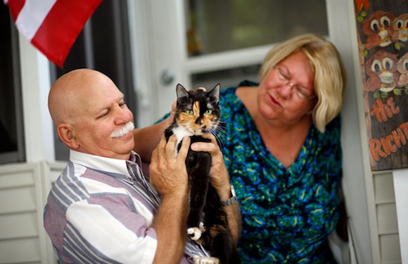 Holly the cat with her owners.